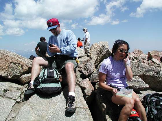 Tom and Shari contacting the real world from the summit