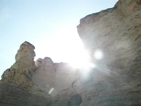 Sun peering over one of the rocks