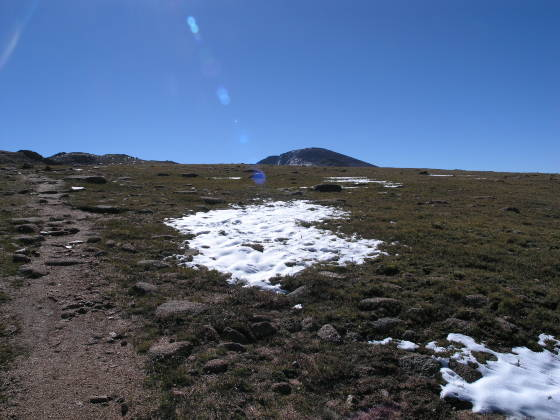 The summit of Pikes Peak is finally visible on the trail