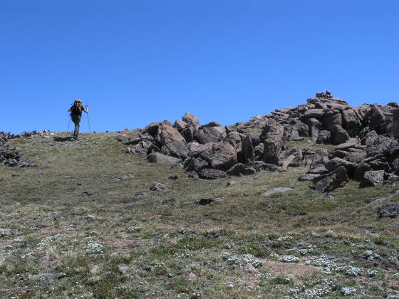 Lonny near the 12,900 ft peak summit (on the right)