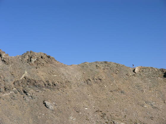 A hiker ascends Kelso Ridge towards Torreys Peak