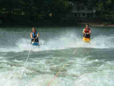 Chrissy and Randy kneeboarding together