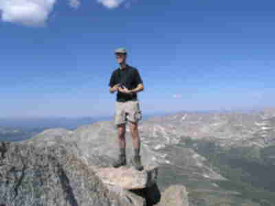 Lonny, precariously poised at the edge of the summit