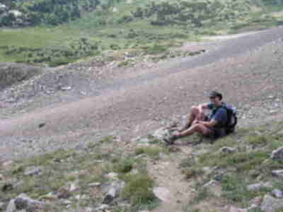 Brian taking a break on the steep descent