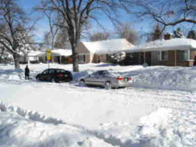 Our neighbors digging out their sedans