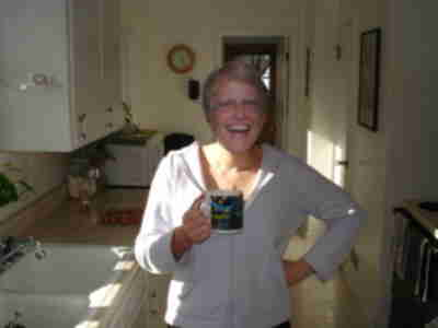 Joan enjoys some fresh made cappucino
