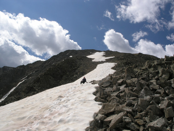 A small snowfield offers a reprieve from boulder-hopping