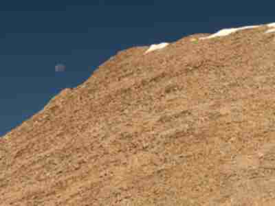The moon just to the left of the Tabeguache summit