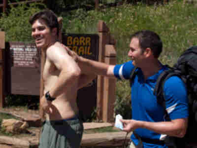 Mike applies sunscreen to Andy...Andy is perhaps enjoying it too much?