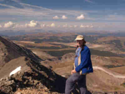Alan on the summit of Crystal, Sawatch range in the distance