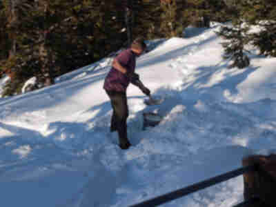 Doug shovels some snow for water