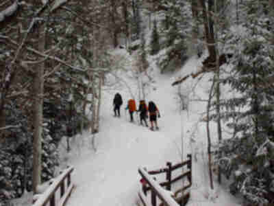 The snowshoers, taking an early lead on the trail