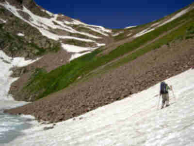 Crossing a snow field while climbing Snow Pass