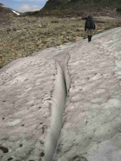 Crossing a small snowfield that's developing a crevasse