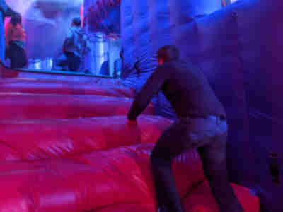 Playing in the massive bouncy castle/ball pit